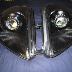 00-05 Mitsubishi Eclipse  TYC headlights FX-R Projectors E46r Shrouds Bezel and Reflector housing painted black
